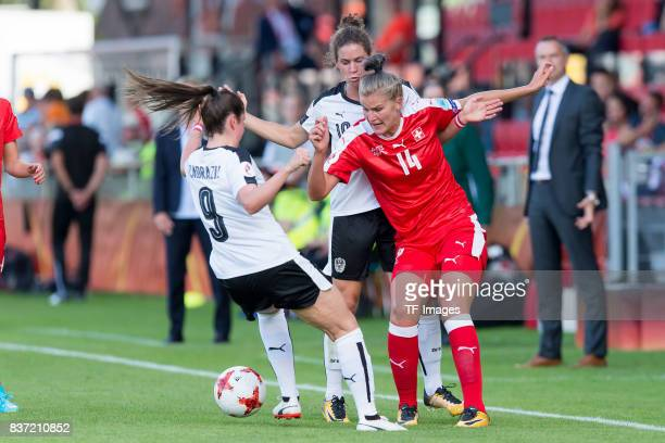 Sarah Zadrazil of Austria and Nina Burger of Austria and Rahel Kiwic of Switzerland battle for the ball during the Group C match between Austria and...
