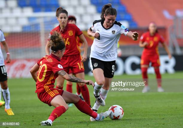 Sarah Zadrazil of Austria vies for the ball with Maria Leon of Spain during the UEFA Womens Euro 2017 quarterfinals football match between Austria...