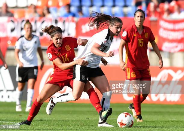 Sarah Zadrazil of Austria vies with Vicky Losada of Spain during the UEFA Women's Euro 2017 quarterfinal football match between Austria and Spain at...