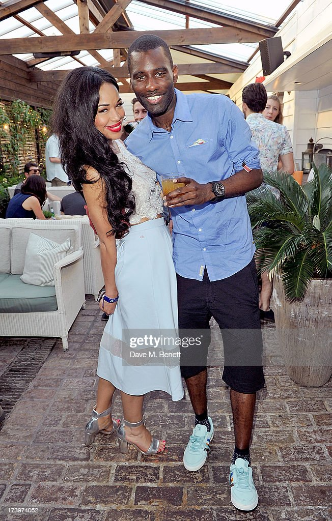 Sarah-Jane Crawford and <a gi-track='captionPersonalityLinkClicked' href=/galleries/search?phrase=Wretch+32&family=editorial&specificpeople=5855963 ng-click='$event.stopPropagation()'>Wretch 32</a> attends Warner music group summer party in association with Esquire at Shoreditch House on July 18, 2013 in London, England.