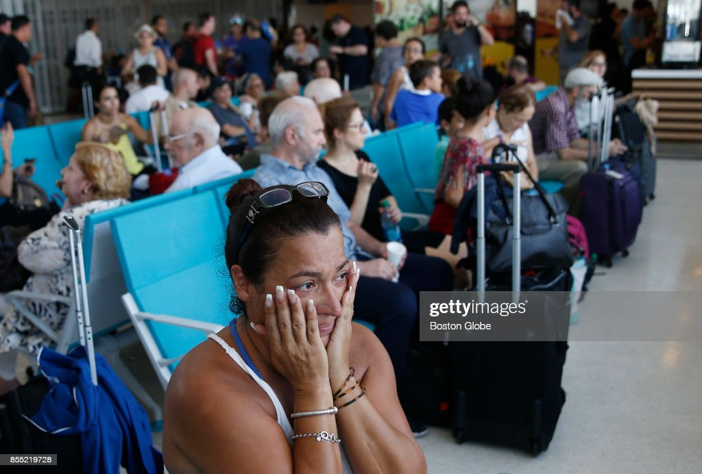 Sarai Class sits at the San Juan Airport in Puerto Rico waiting for a flight on Sep. 28, 2017. She had been waiting for two days, as many seek to leave the country in the aftermath of Hurricane Maria.