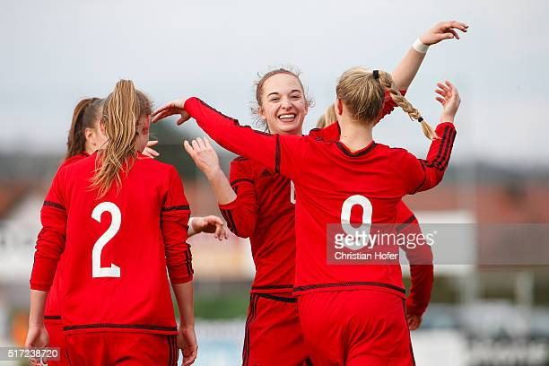Sarai Linder Sophia Kleinherne and AnnaLena Stolze of Germany celebrate after scoring during the U17 Girl's Euro Qualifier match between Austria and...