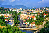 Aerial view of Sarajevo, the capital of Bosnia and Herzegovina, with Latin Bridge, Miljacka River, National Library and the modern city