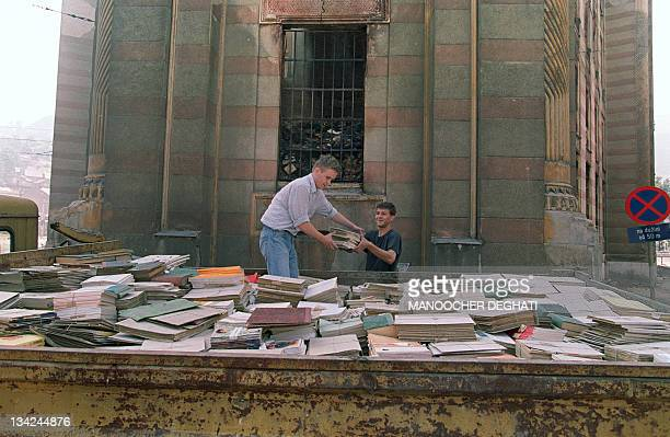 Sarajevo residents try to save some books from the basement of the National Library in Sarajevo on August 29 1992 The Historical Library buiding of...