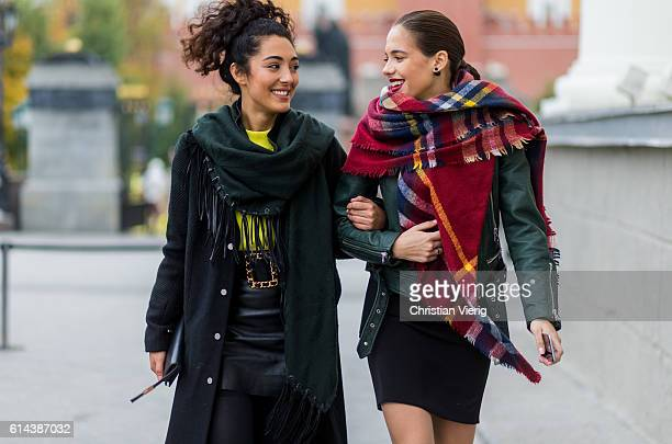 SaraJoleen Kaveh Moghaddam and Katerina Sibrina wearing an oversized plaid scarf green biker leather jacket and black dress during MercedesBenz...