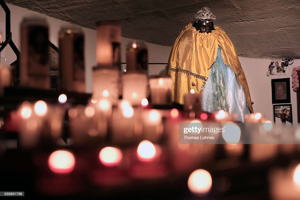 Sara's statue in the crypt of the church pictured on May 24, 2016 in Staintes Maries de la Mere near Arles, France. Gypsies from all over Europe worship 'Sara the Black', their Saint and patroness, for one week. She wears a multicoloured dress and will carried by the gypsies to the sea at this afternoon.