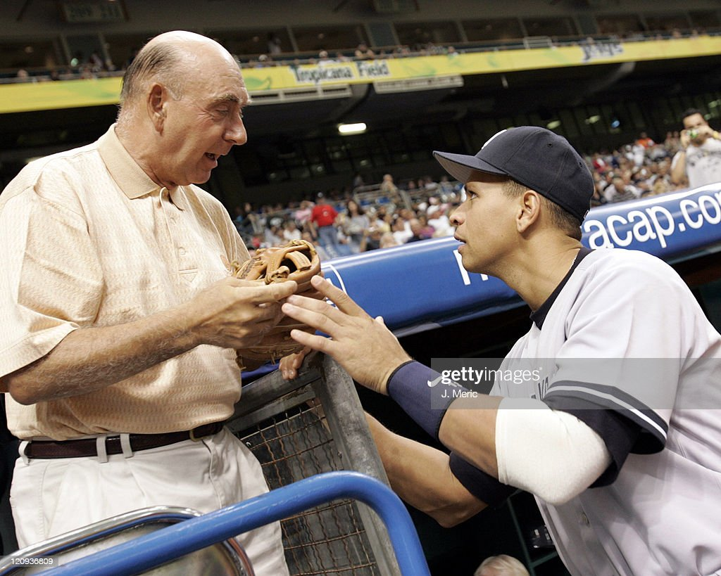 Sarasota resident <a gi-track='captionPersonalityLinkClicked' href=/galleries/search?phrase=Dick+Vitale&family=editorial&specificpeople=730924 ng-click='$event.stopPropagation()'>Dick Vitale</a> gets some advice from New York Yankee third baseman Alex Rodriguez prior to Monday night's game against the Tampa Bay Devil Rays at Tropicana Field in St. Petersburg, Florida on May 2, 2005.