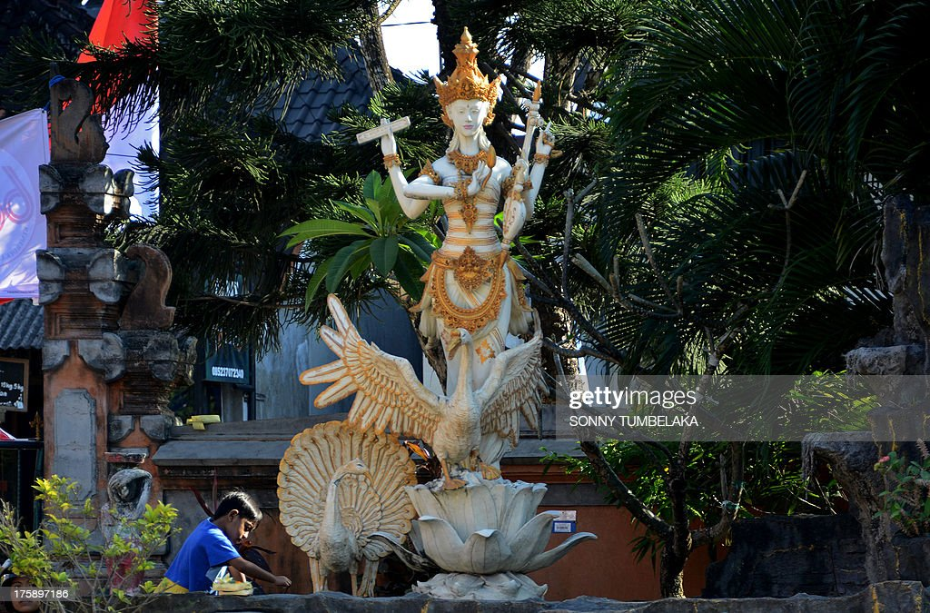 A Saraswati statue is displayed during the Hindu Saraswati holy day at a school in Denpasar on Bali island on August 10, 2013. Hindu devotees in Bali celebrated Saraswati day - the day to worship God in his manifestation as the master of all knowledge.