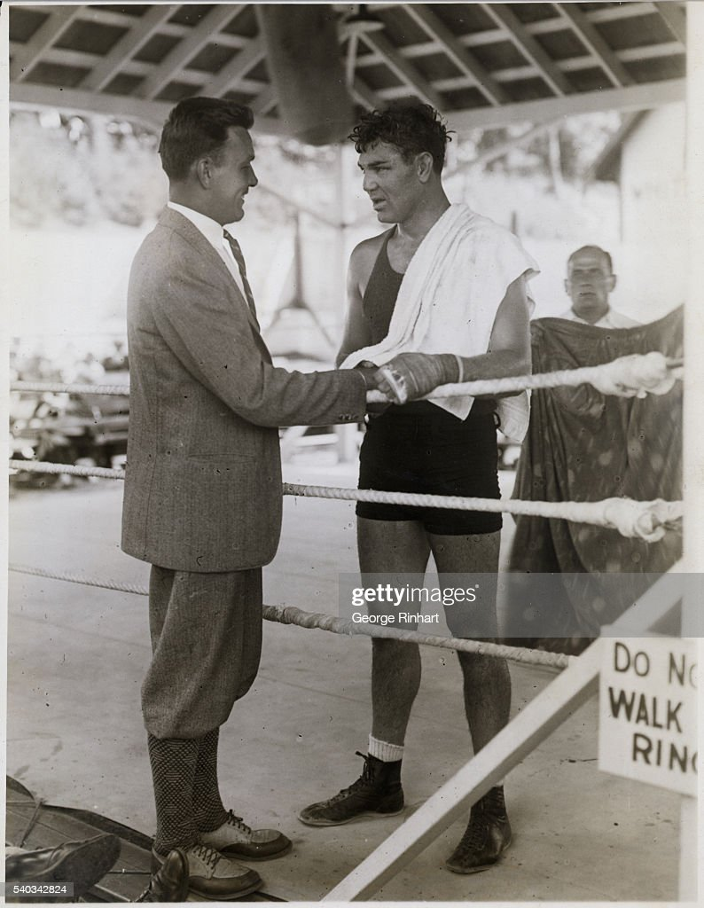 Jack Dempsey former heavyweight champion goes thru some strenuous workouts with his sparring partners in preparation for the coming bout with Jack...