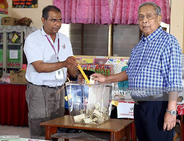 Sarawak Chief Minister Adenan Satem poses while casting his vote at a polling station in Kuching on May 7 2016 Malaysia's largest state went to the...