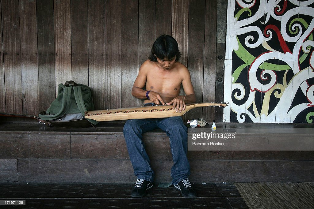 A Sarawak native repairs a traditional musical instrument called Sape during the Rainforest World Music Festival on June 30, 2013 in Kuching, Sarawak, Malaysia. The Rainforest World Music Festival was recognized as one of the 25 Best International Festivals by renowned world music magazine, Songlines, draws thousands of revelers every year from all over the world.