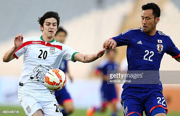 Sardar Azmoun and Yoshida Maya in action during the international friendly match between Iran and Japan at Azadi Stadium on October 13 2015 in Tehran...