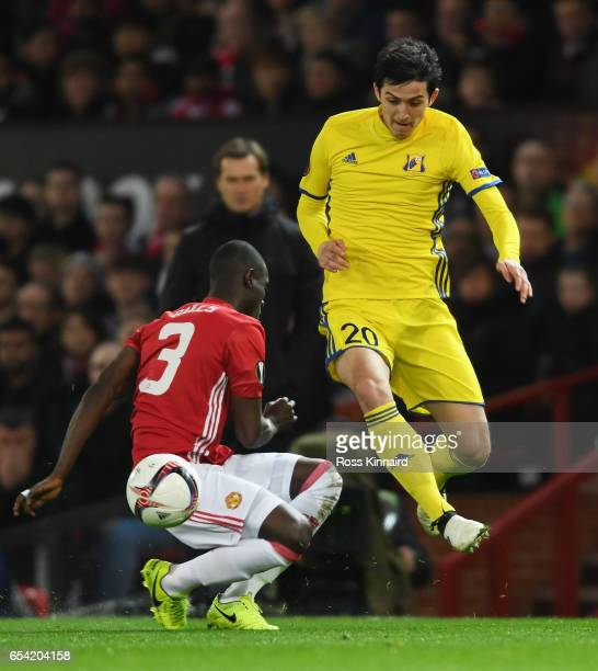 Sardar Azmoun of FC Rostov is tackled by Eric Bailly of Manchester United during the UEFA Europa League Round of 16 second leg match between...