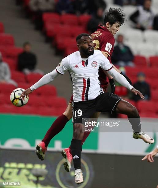 Sardar Azmoun of FC Rubin Kazan vies for the ball with Brian Idowu FC Amkar Perm during the Russian Premier League match between FC Rubin Kazan and...