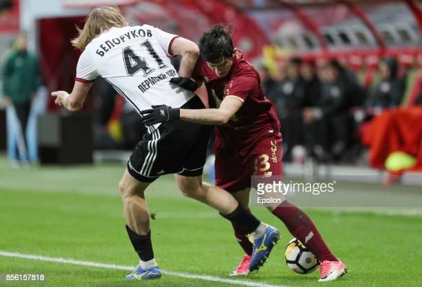 Sardar Azmoun of FC Rubin Kazan vies for the ball with Dmitri Belorukov FC Amkar Perm during the Russian Premier League match between FC Rubin Kazan...