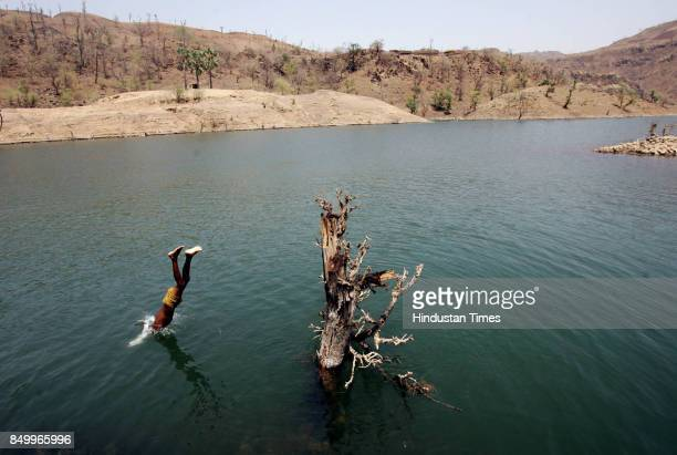 Sardar Sarovar Project Rehabilitation A tribal child dives into the water which submerged many fertile fields of Kakrana village in Madhya Pradesh...