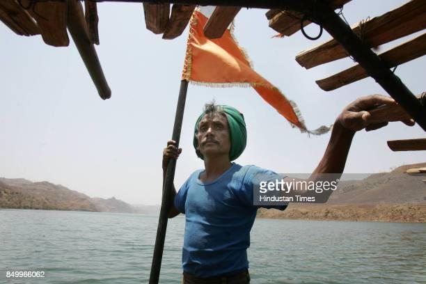 Sardar Sarovar Project Rehabilitation Sardiya Nan Singh a tribal of Kakrana village in Madhya Pradesh makes a living ferrying people on his boat His...