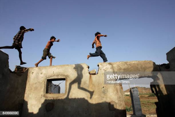 Sardar Sarovar Project Rehabilitation Tribal children play on a broken down house at a rehabilitation site in Barwani district Many tribals are not...