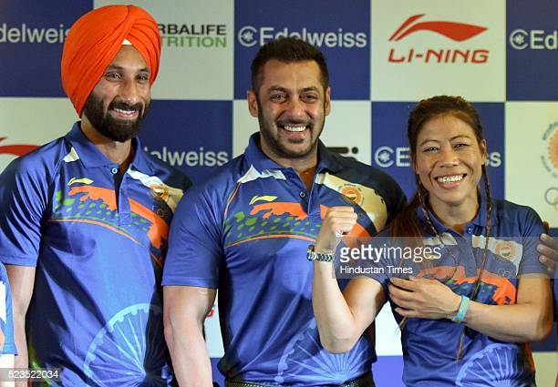 Sardar Singh Captain Indian Women Hockey Team Bollywood actor Salman Khan with Olympic Bronze Medalist MC Mary Kom during a press conference to...
