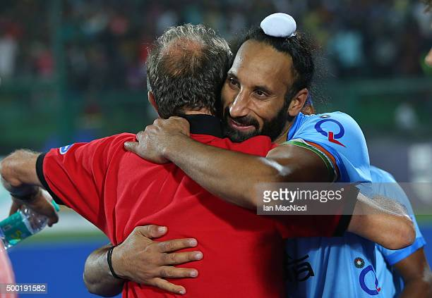 Sardar Singh captain of India hugs coach Roelant Oltmans after India win the penalty shoot out for third place during the match between Netherlands...