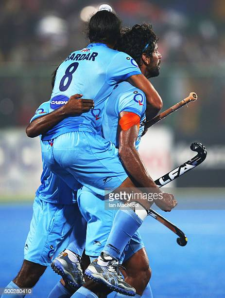 Sardar Singh captain of India jumps on Rupinder Pal Singh of India during the match between Netherlands and India on day ten of The Hero Hockey...