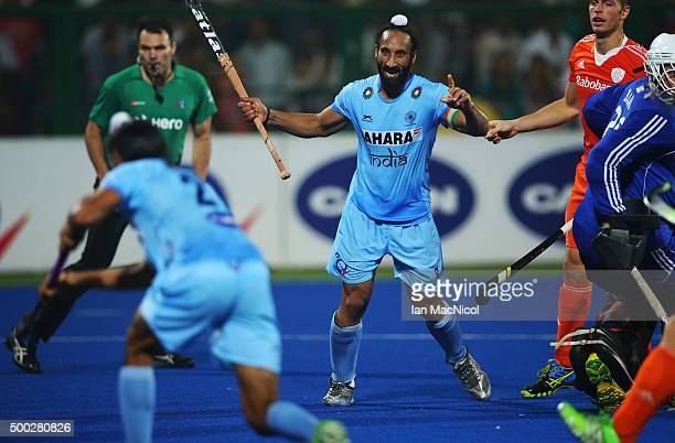 Sardar Singh captain of India looks on as Akashdeep Singh of India scores during the match between Netherlands and India on day ten of The Hero...