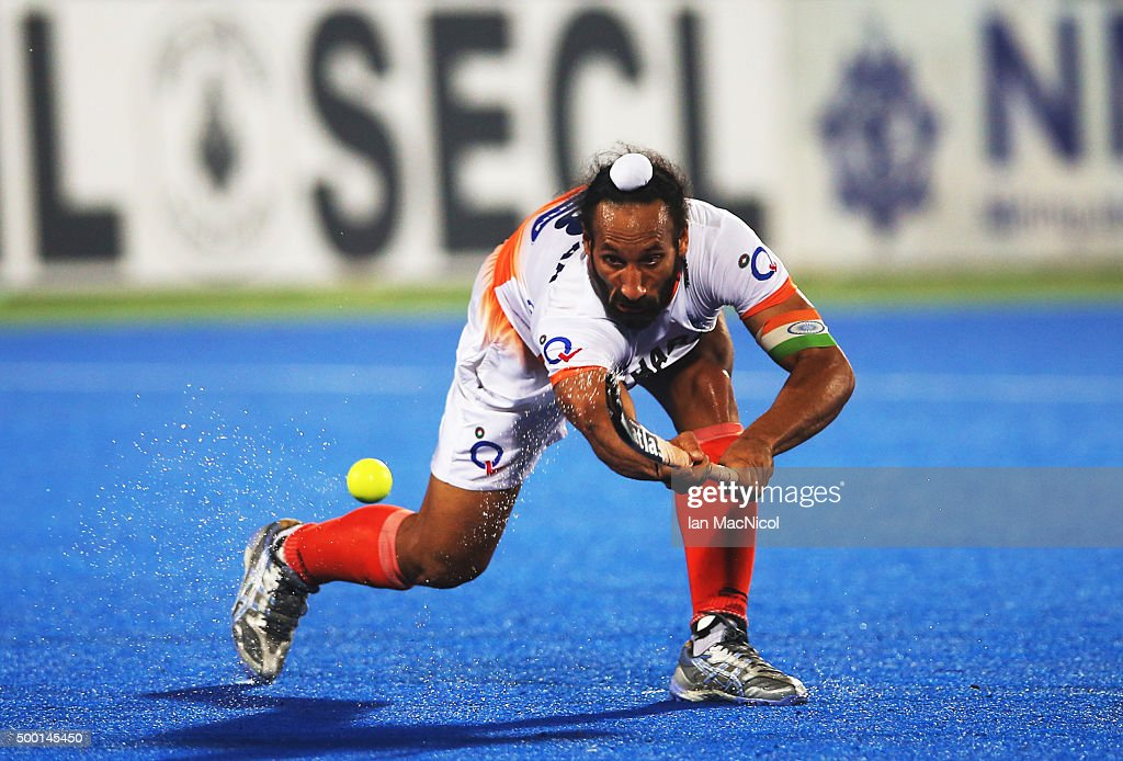 Sardar Singh captain of India passes the ball during the match between India and Belgium on day nine of The Hero Hockey League World Final at the Sardar Vallabh Bhai Patel International Hockey Stadium on December 05, 2015 in Raipur, India.