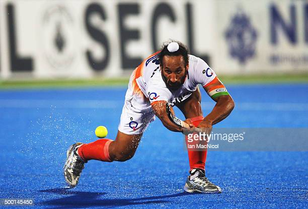 Sardar Singh captain of India passes the ball during the match between India and Belgium on day nine of The Hero Hockey League World Final at the...