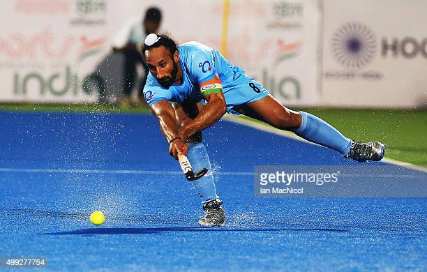 Sardar Singh captain of India strikes the ball during the match between Netherlands and India on day four of The Hero Hockey League World Final at...