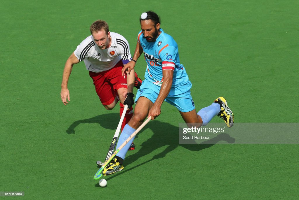 Sardar Singh of India and Barry Middleton of England compete for the ball during the match between England and India on day one of the Champions Trophy on December 1, 2012 in Melbourne, Australia.