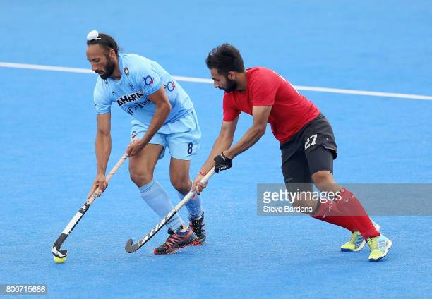 Sardar Singh of India and Sukhi Panesar of Canada battle for possession during the 5th/6th place match between India and Canada on day nine of the...