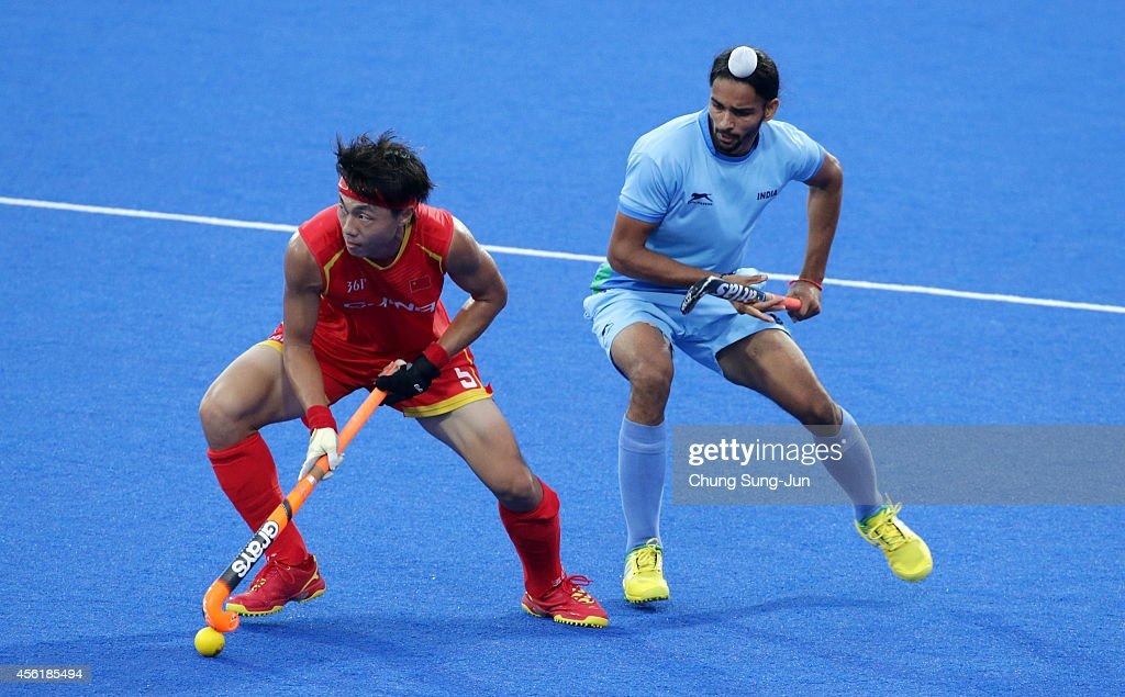 Sardar Singh of India competes for the ball with Wang Zipeng of China during the Hockey Men's Pool B match between India and China during the 2014 Asian Games at Seonhak Hockey Stadium on September 27, 2014 in Incheon, South Korea.