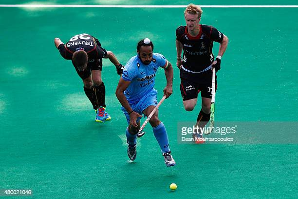 Sardar Singh of India gets past the Jerome Truyens and Amaury Keusters of Belgium during the Fintro Hockey World League SemiFinal match between India...