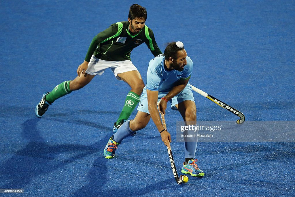 Sardar Singh of India (R) in action during the men's hockey gold medal match on day thirteen of the 2014 Asian Games between India and Pakistan at Seonhak Hocky Stadium on October 2, 2014 in Incheon, South Korea.