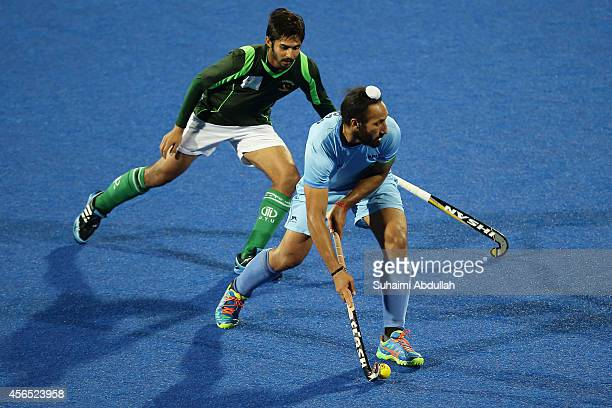 Sardar Singh of India in action during the men's hockey gold medal match on day thirteen of the 2014 Asian Games between India and Pakistan at...