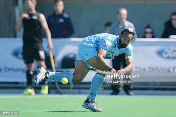Sardar Singh of India passes the ball during the international men's hockey test match between the New Zealand Black Sticks and India on October 11...