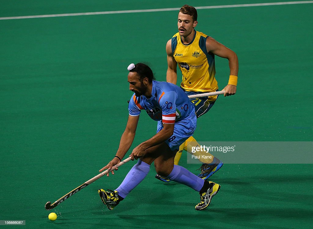 Sardar Singh of India runs onto the looks to pass the ball in the mens Australia Kookaburras v India game during day two of the 2012 International Super Series at Perth Hockey Stadium on November 23, 2012 in Perth, Australia.