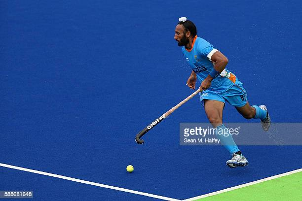 Sardar Singh of India runs upfield against Canada uring a Men's Preliminary Pool B match on Day 7 of the Rio 2016 Olympic Games at the Olympic Hockey...