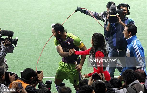 Sardar Singh with Actor Kajal Aggarwal and Akshay Kumar during Hockey India League match between Delhi Waveriders and Punjab Warriors at Major Dhyan...