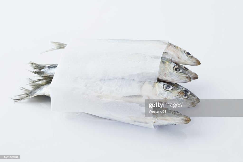 Sardines in wax paper on white background : Stock Photo