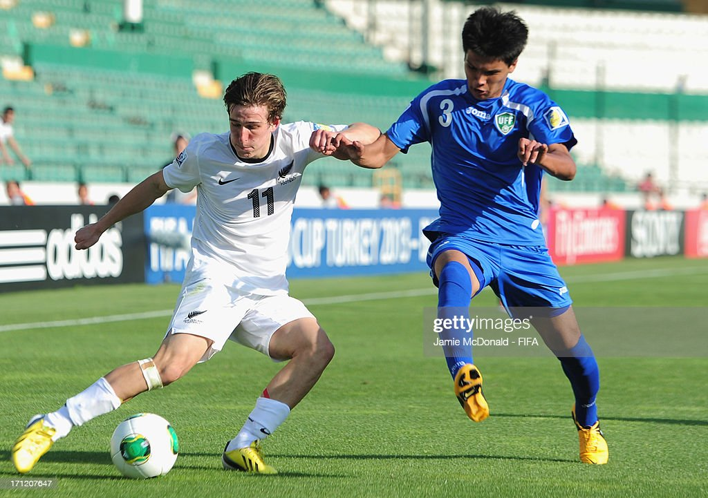 Sardor Rakhmanov of Uzbekistan battles with Louis Fenton of New Zealand during the FIFA U-20 World Cup Group F match between New Zealand and Uzbekistan at the Ataturk Stadium on June 23, 2013 in Bursa, Turkey.
