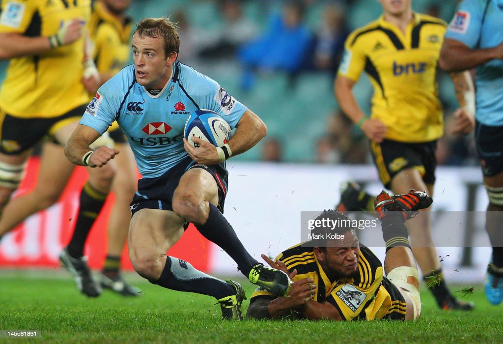 <a gi-track='captionPersonalityLinkClicked' href=/galleries/search?phrase=Sarel+Pretorius&family=editorial&specificpeople=4360546 ng-click='$event.stopPropagation()'>Sarel Pretorius</a> of the Waratahs evades the tackle of Julian Savea of the Hurricanes during the round 15 Super Rugby match between the Waratahs and the Hurricanes at Allianz Stadium on June 2, 2012 in Sydney, Australia.