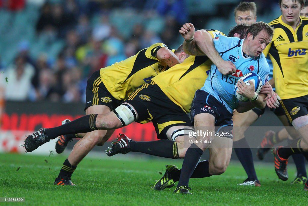 <a gi-track='captionPersonalityLinkClicked' href=/galleries/search?phrase=Sarel+Pretorius&family=editorial&specificpeople=4360546 ng-click='$event.stopPropagation()'>Sarel Pretorius</a> of the Waratahs is tackled during the round 15 Super Rugby match between the Waratahs and the Hurricanes at Allianz Stadium on June 2, 2012 in Sydney, Australia.