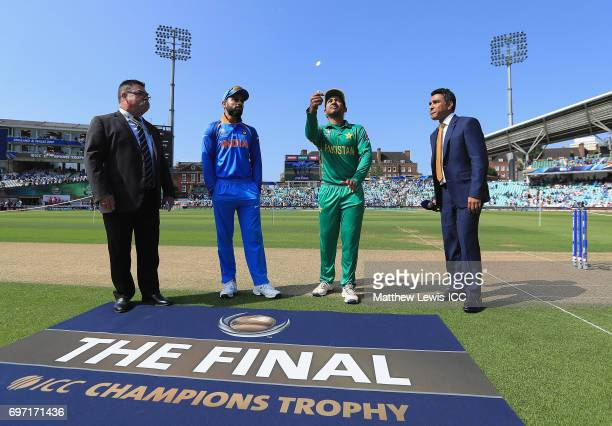 Sarfaraz Ahmad captain of Pakistan and Virat Kohli captain of India pictured during the coin toss ahead of the ICC Champions Trophy Final between...