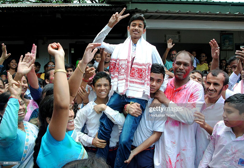 Sarfaraz Hussain topped the Assam boards HSLC examination 2016 celebrating his success with his school friends at school Sankardev Sishu Niketan, Betkuchi premises on May 31, 2016 in Guwahati, India. Sarfaraz who has scored 590 marks out of a maximum 600 in Class 10 exam is student of Sankardev Sishu Niketan school run by an affiliate of Vidya Bharati, the RSSs education wing.