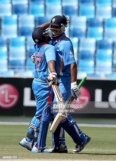 Sarfaraz Khan and Deepak Hooda celebrate after winning the ICC U19 Cricket World Cup 2014 match between India and Scotland at the Dubai Sports City...