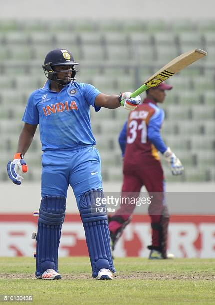 Sarfaraz Khan of India acknowledges teammates after scoring a half century during the ICC U19 World Cup Final Match between India and West Indies on...