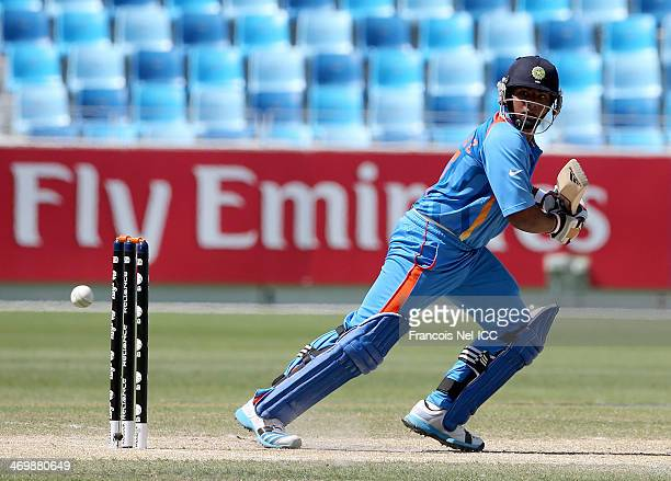 Sarfaraz Khan of India bats during the ICC U19 Cricket World Cup 2014 match between India and Scotland at the Dubai Sports City Cricket Stadium on...