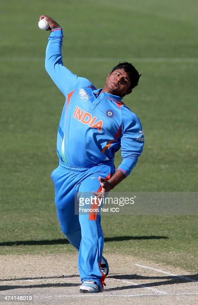 Sarfaraz Khan of India bowls during the ICC U19 Cricket World Cup 2014 Quarter Final match between England and India at the Dubai Sports City Cricket...