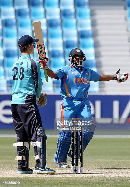 Sarfaraz Khan of India celebrates after hitting the winning runs during the ICC U19 Cricket World Cup 2014 match between India and Scotland at the...